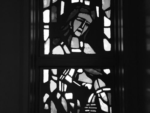 Image of Good Samaritan in stained glass, greyscale